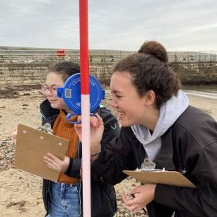 Year 10 Geographers undertaking field work on Swanage Beach